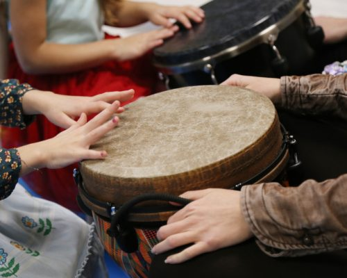 Kids,Play,Jembe,Drum,In,A,Montessori,Music,Therapy,Classroom